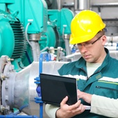 BMOC-like engineer in the field with a tablet capturing data
